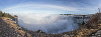 Panorama of fog-filled Creux du Van