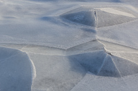 Ice pyramids, formed around rocks underneath