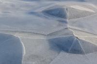 Ice pyramids, formed around rocks underneath