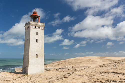 Rubjerg Knude Lighthouse at the edge of the cliff...