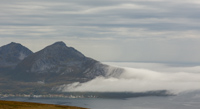 The next morning I watched the fog roll in like a waterfall behind Tromvik
