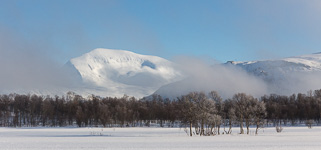 Tromsdalstinden appearing out of the fog - beautiful!