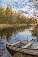 Half sunken rowing boat near the cabin