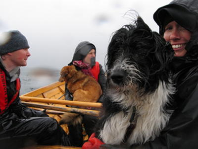 6 people + 2 dogs in one boat, all very wet