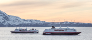 The southbound MS Vesterålen and the northbound MS Polarlys meeting just in front of the lighthouse