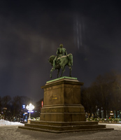 Light pillars over the statue in front of the palace