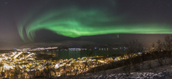 A panorama of the northern lights over Hamna, Tromsø