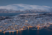 The city centre of Tromsø, with behind it the airport and behind that the island Kvaløya