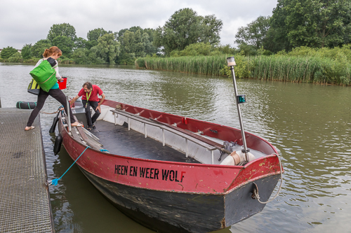 Laura getting on board the next morning. The boat is called Heen en Weer Wolf, a character from a children's book. In English the character is called Tell me Wherewoulf