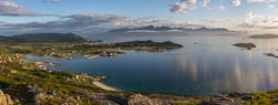 Panorama of Brensholmen, the ferry just departed towards Senja (the island in the background)