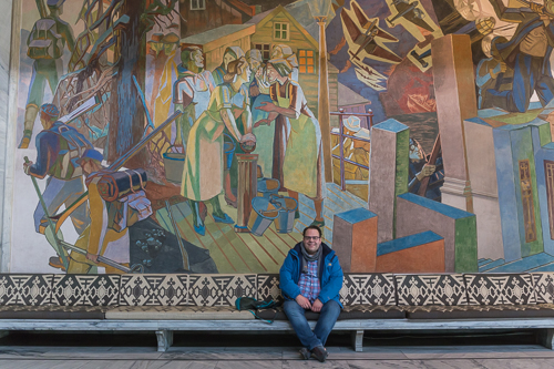 Michiel in front of one of the many murals inside Oslo city hall