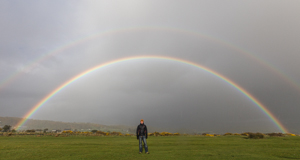 Paul posing under the very bright double rainbow