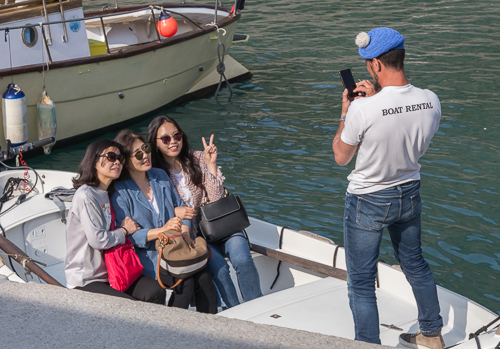 Funny tourists going on boat trip ;)