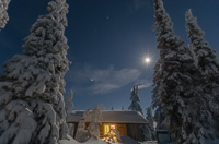 The cabin on a starry moonlit night