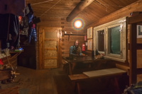 Inside the simple but cozy cabin - the magic light is Paul's gas lamp hanging from the ceiling