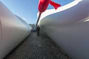 The MASSIVE blades of a windturbine ready to be built - they are 50 m long!