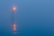 A channel marker in the fog