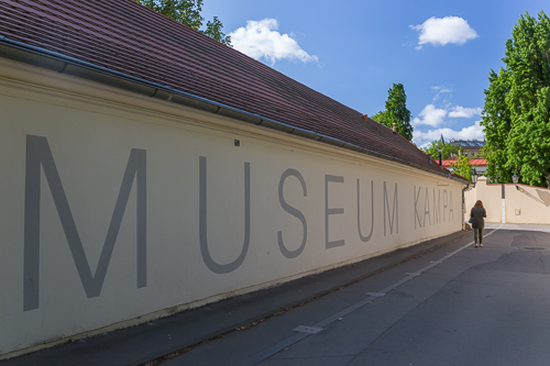 My sister walking past the Kampa Museum