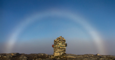 A magical moment when the clouds disappeared just when I reached the top, and a strong fogbow appeared