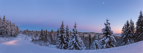 Incredible twilight colours on the lit skitrail from Frognerseteren