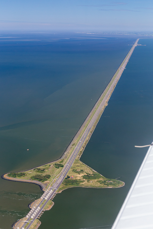 De Afsluitdijk, a 32 km long dike that closes off the IJsselmeer (now a lake, previously sea)