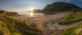 Panorama of Grøtfjord beach, just before the sun disappears behind Vengsøya