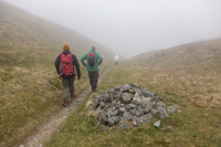 The clouds rolled in soon after we left Cerrig Arthur behind. Here we are relieved to have reached the highest point, but the path down was not the easiest
