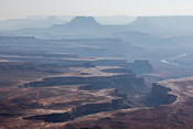 Looking down on the White Rim and (further in the distance) the Green River