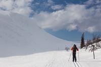 Skiing through a narrow valley
