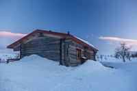 Sioskuru Open Wilderness Hut at sunset