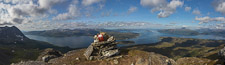 Panorama from the top: Bentsjordtinden on the left, the island Ryøya behind the cairn, Tromsø a bit further to the right and at the far right you can see all the way into Ramfjorden