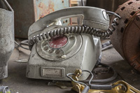 An old phone in one of the abandoned buildings