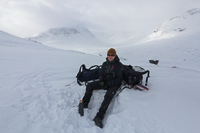 A much needed break after herring-boning up a steep and icy slope. The three dots in the background are the cabins at Hunddalshyttene...