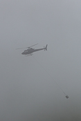 Helicopter flying in the mist