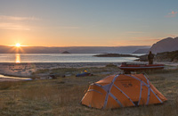 Setting up camp in the midnight sun
