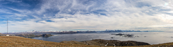 Panorama from the top, with views of Rebbenesøya, Ringvassøya, Kvaløya, Senja and even all the way to Andenes (though that is impossible to see in this photo)