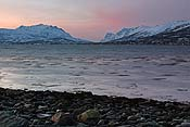 Looking towards Ersfjorden, the sea in the foreground is blurred because of the long exposure