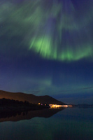 Green & blue beams above Tromsø island