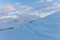 Beautiful sculpted snow, with Tromsdalstinden in the background