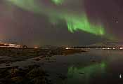 Northern lights on the last day of 2011, reflected in the fjord