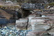 A small bridge crosses the rocks at Oldervik