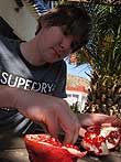Paul enjoying his favourite fruit, which they grow a lot on Crete: pomegranates