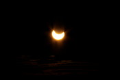 Close to the maximum of the eclipse, around 23:30
