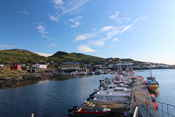 The harbour of Breivikbotn. Fishing is big business, people come from far to catch big fish here.